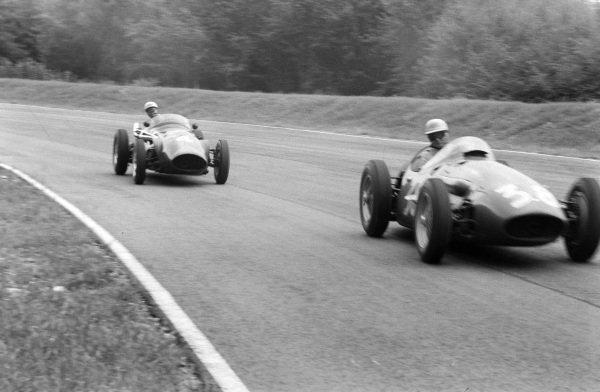 Chico Godia-Sales, Maserati 250F, leads Ron Flockhart, Connaught B Alta.
