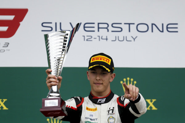 Race winner Leonardo Pulcini (ITA) Hitech Grand Prix on the podium with the trophy