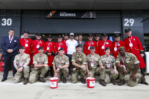 Carlos Sainz Jr, McLaren and Lando Norris, McLaren with the Chelsea Pensioners