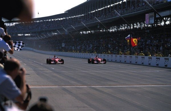 Michael Schumacher (GER) Ferrari F2002 and team mate Rubens Barrichello (BRA) Ferrari F2002 cross the line just 0.010 seconds apart for the closest finish in F1 history.
