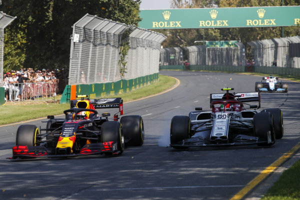 Pierre Gasly, Red Bull Racing RB15, battles with Antonio Giovinazzi, Alfa Romeo Racing C38