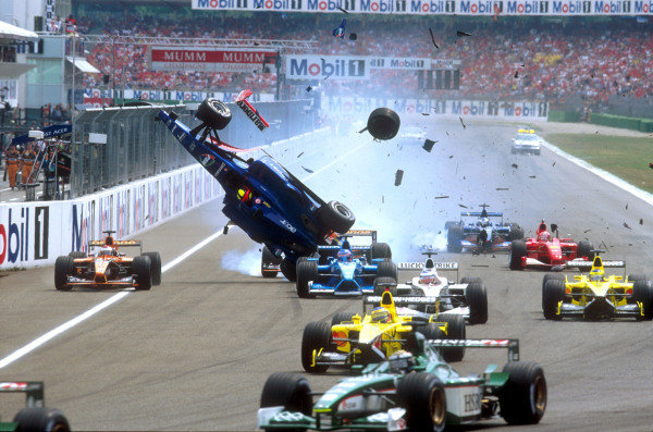2001 German Grand Prix - Race.Hockenheim, Germany. 29th July 2001.Luciano Burti, Prost Acer AP04, is launched into the air, after crashing into the back of the slowing Ferrari of Michael Schumacher. Start action.World Copyright: Charles Coates/LAT Photographic.ref: 35mm Image A03