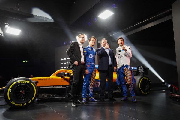 Zak Brown, Executive Director, McLaren, Andreas Seidl, Team Principal, McLaren, Carlos Sainz Jr, McLaren, and Lando Norris, McLaren watch the launch of the McLaren MCL35