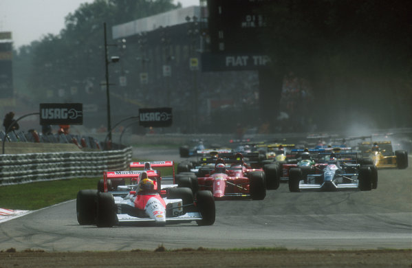 1990 Italian Grand Prix.Monza, Italy.7-9 September 1990.Ayrton Senna leads teammate Gerhard Berger (both McLaren MP4/5B Honda's), Alain Prost (Ferrari 641), Jean Alesi (Tyrrell 019 Ford) and Nigel Mansell (Ferrari 641) at the start.Ref-90 ITA 01.World Copyright - LAT Photographic