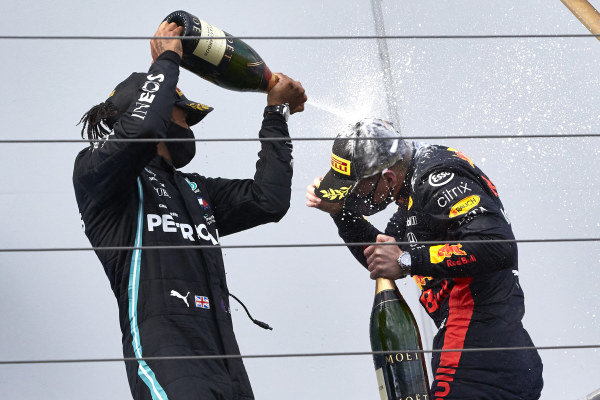 Lewis Hamilton, Mercedes-AMG Petronas F1, 1st position, sprays Champagne at Max Verstappen, Red Bull Racing, 2nd position, on the podium