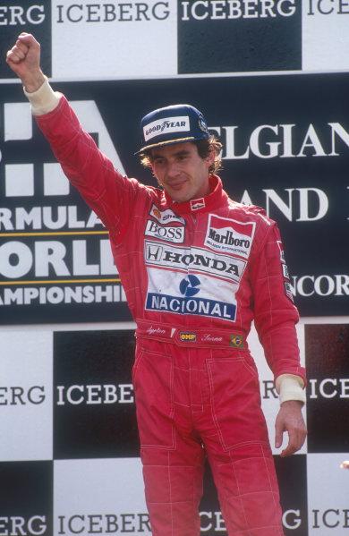1991 Belgian Grand Prix.Spa-Francorchamps, Belgium.23-25 August 1991.Ayrton Senna (McLaren Honda) celebrates 1st position on the podium.Ref-91 BEL 27.World Copyright - LAT Photographic