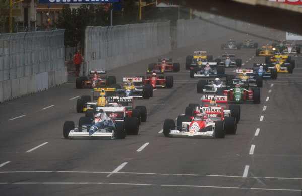 1990 United States Grand Prix.Phoenix, Arizona, USA.9-11 March 1990.Jean Alesi (Tyrrell 018 Ford) dives down the inside of Gerhard Berger (Mclaren MP4/5B Honda) to lead, followed by Andrea de Cesaris (Dallara 190 Ford), Ayrton Senna (Mclaren MP4/5B Honda) and Pierluigi Martini (Minardi M189 Ford), Nelson Piquet (Benetton B189B Ford) and Thierry Boutsen (Williams FW13B Renault) at the start.Ref-90 USA 03.World Copyright - LAT Photographic