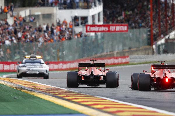 The Safety Car leads Charles Leclerc, Ferrari SF90, and Sebastian Vettel, Ferrari SF90