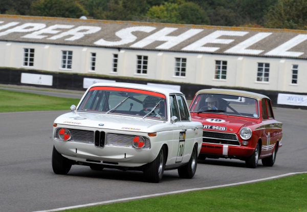 Goodwood Estate, West Sussex, 15th - 18th September 2011 St Mary's Trophy Race 1 Andy Priaulx, BMW 1800 TiSA, leads Emanuele Pirro, Ford-Lotus Cortina Mk1. World Copyright:Jeff Bloxham/LAT Photographic Ref: Digital Image