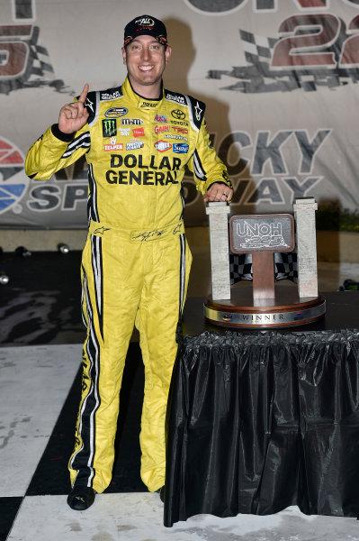 26 June, 2014, Sparta, Kentucky USA Kyle Busch celebrates his win in Victory Lane ?2014, Nigel Kinrade LAT Photo USA