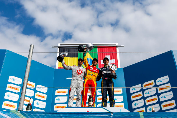 2014/2015 FIA Formula E Championship. Berlin ePrix, Berlin Tempelhof Airport, Germany. Saturday 23 May 2015 Podium. 1st, Lucas di Grassi (BRA)/Audi Abt Sport - Spark-Renault SRT_01E, 2nd, Jerome D'Ambrosio (BEL)/Dragon Racing - Spark-Renault SRT_01E and 3rd, Sebastien Buemi (SWI)/E.dams Renault - Spark-Renault SRT_01E. Photo: Zak Mauger/LAT/Formula E ref: Digital Image _L0U9701