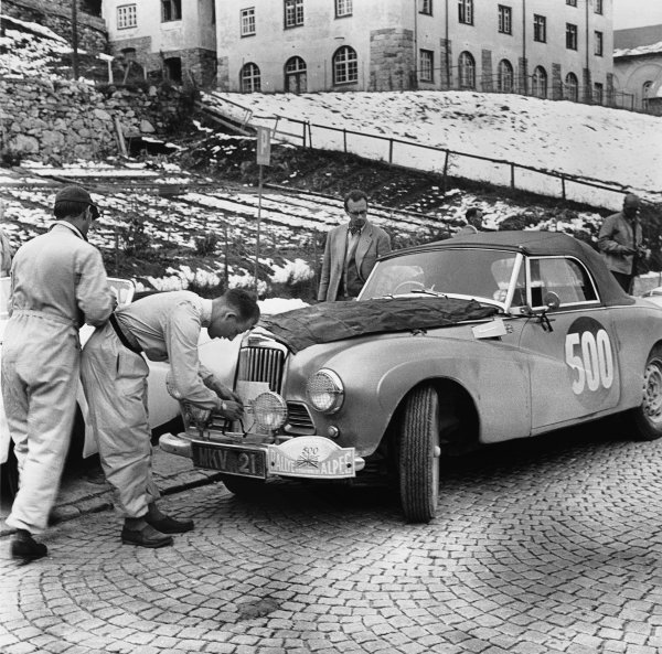 9th - 16th July 1954.Stirling Moss / John Cutts (Sunbeam-Talbot Alpine), 1st position, making adjustments to the cooling system on their way to win a Gold Coupe des Alpes, action.World Copyright: LAT Photographic.Ref:  Autocar Glass Plate C40284.