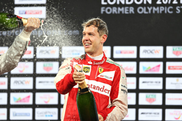 2015 Race Of Champions Olympic Stadium, London, UK Saturday 21 November 2015 Sebastian Vettel (GER) celebrates his Race of Champions win on the podium Copyright Free FOR EDITORIAL USE ONLY. Mandatory Credit: 'IMP'