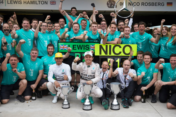 Interlagos, Sao Paulo, Brazil. Sunday 15 November 2015. Lewis Hamilton, Mercedes AMG, 2nd Position, Nico Rosberg, Mercedes AMG, 1st Position, and the Mercedes team celebrate victory. World Copyright: Steve Etherington/LAT Photographic ref: Digital Image SNE22885