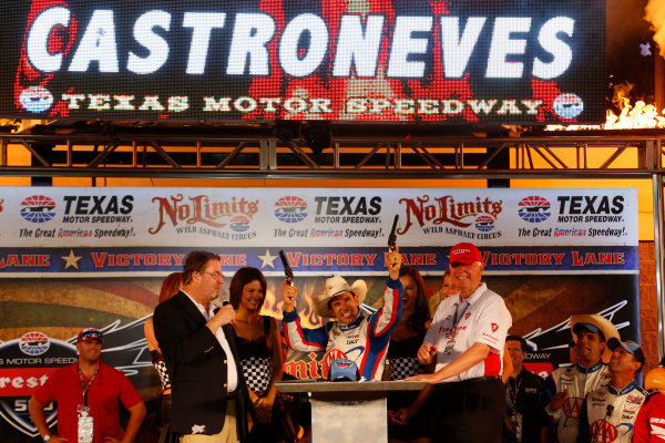 7-8 June, 2013, Fort Worth, Texas USA Helio Castroneves poses with the pistols in victory lane ©2013, Lesley Ann Miller LAT Photo USA