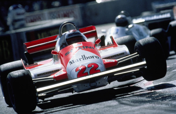 Mario Andretti, Alfa Romeo 179C, bounces over a kerb.