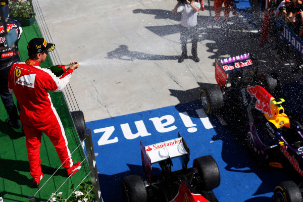 Hungaroring, Budapest, Hungary. Sunday 26 July 2015. Sebastian Vettel, Ferrari, 1st Position, sprays the victory Champagne. World Copyright: Alastair Staley/LAT Photographic ref: Digital Image _79P0940