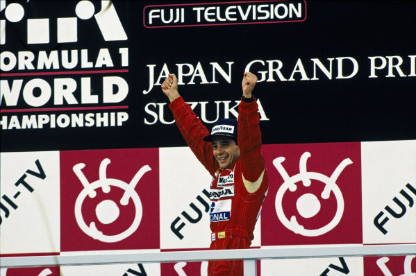 Suzuka, Japan.28-30 October 1988.Ayrton Senna (McLaren Honda) 1st position celebrates on the podium.Ref-88 JAP 08.World Copyright - LAT Photographic