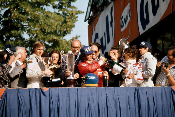 Monza, Italy. 6-8 September 1974. Ronnie Peterson (Lotus Ford) 1st position, Emerson Fittipaldi (McLaren Ford) 2nd position and Jody Scheckter (Tyrrell Ford) 3rd position on the podium.  World Copyright: LAT Photographic. Ref: 74ITA