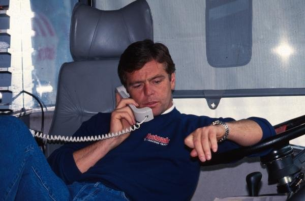 Derek Warick on the phone in the Footwork motorhome.