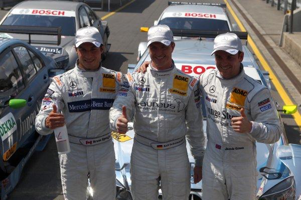Top three qualifyers: Pole man Ralf Schumacher(GER), Laureus AMG Mercedes, centre; Bruno Spengler (CDN), Mercedes-Benz Bank AMG, left, (2nd); Jamie Green (GBR), Junge Sterne AMG Mercedes, right, (3rd).DTM, Rd4, Norisring, Nuremberg, Germany. 2-4 July 2010 World Copyright: LAT PhotographicRef: Digital Image dne1003jy71
