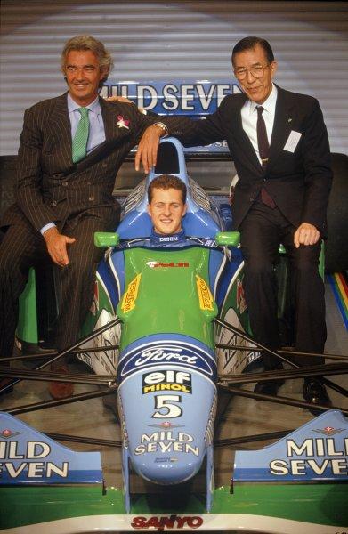 1994 Mild Seven Benetton sponsorship launch.Flavio Briatore, Michael Schumacher and Shigeru Mizuno.World Copyright: LAT Photographic