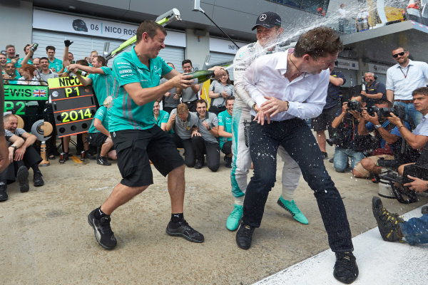 Red Bull Ring, Spielberg, Austria. Sunday 22 June 2014. Nico Rosberg, Mercedes AMG, 1st Position, and the Mercedes AMG team celebrate victory. World Copyright: Steve Etherington/LAT Photographic. ref: Digital Image SNE26776copy