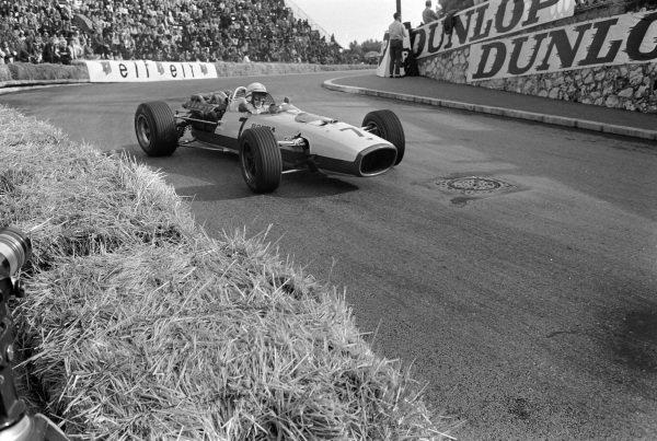 John Surtees, Honda RA273, corrects a slide at Station hairpin.