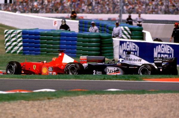 2000 French Grand Prix. Magny-Cours, France.  30/6-2/7 2000. David Coulthard (McLaren MP4/15 Mercedes) tells Michael Schumacher (Ferrari F1-2000) what he thinks of his driving manoeuvres at the Hairpin. World Copyright - LAT Photographic Format: 35mm transparency