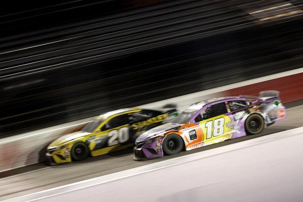 Erik Jones, Joe Gibbs Racing Toyota STANLEY, leads Kyle Busch, Joe Gibbs Racing Toyta M&M's Fudge Brownie, Copyright: Chris Graythen/Getty Images.