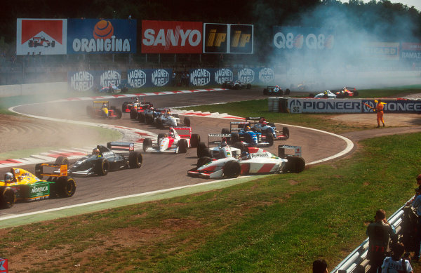 1993 Italian Grand Prix.Monza, Italy.10-12 September 1993.Derek Warwick (Footwork FA14 Mugen-Honda) is hit and spun by teammate Aguri Suzuki in the Rettifilo Chicane at the start after being tapped by Wendlinger. Behind Rubens Barrichello (Jordan 193 Hart) retires after he spun on the approach to the chicane. Marco Apicella (Jordan 193 Hart) and J J. Lehto (Sauber C12 Ilmor) also retire as they were hit trying to avoid the spinning Barrichello.Ref-93 ITA 01.World Copyright - LAT Photographic