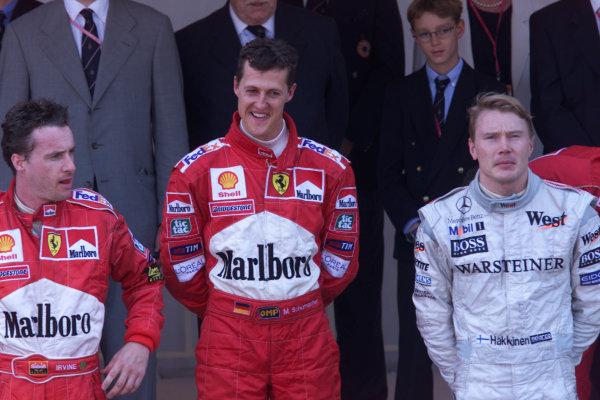 1999 Monaco Grand Prix.Monte Carlo, Monaco.13-16 May 1999.Michael Schumacher (Ferrari) 1st position, Eddie Irvine (Ferrari) 2nd position and Mika Hakkinen (McLaren Mercedes) 3rd position on the podium.World Copyright - Lawrence/LAT Photographic