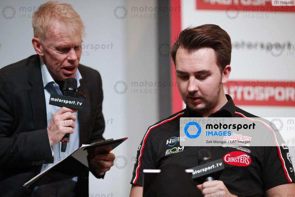 Presenter Alan Hyde talks to Tom Ingram on the Autosport stage
