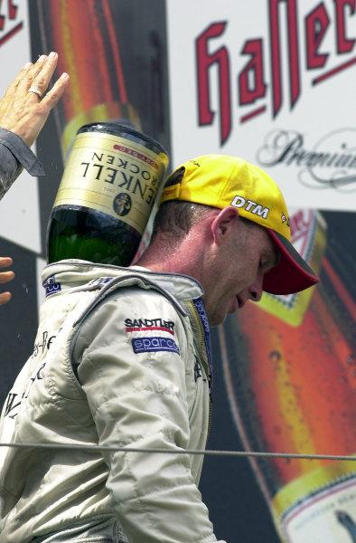 2002 DTM Championship Nurburgring, Germany. 2th - 4th August 2002.Race winner Uwe Alzen (Mercedes CLK-DTM), podium. World Copyright: Andre Irlmeier/LAT Photographic