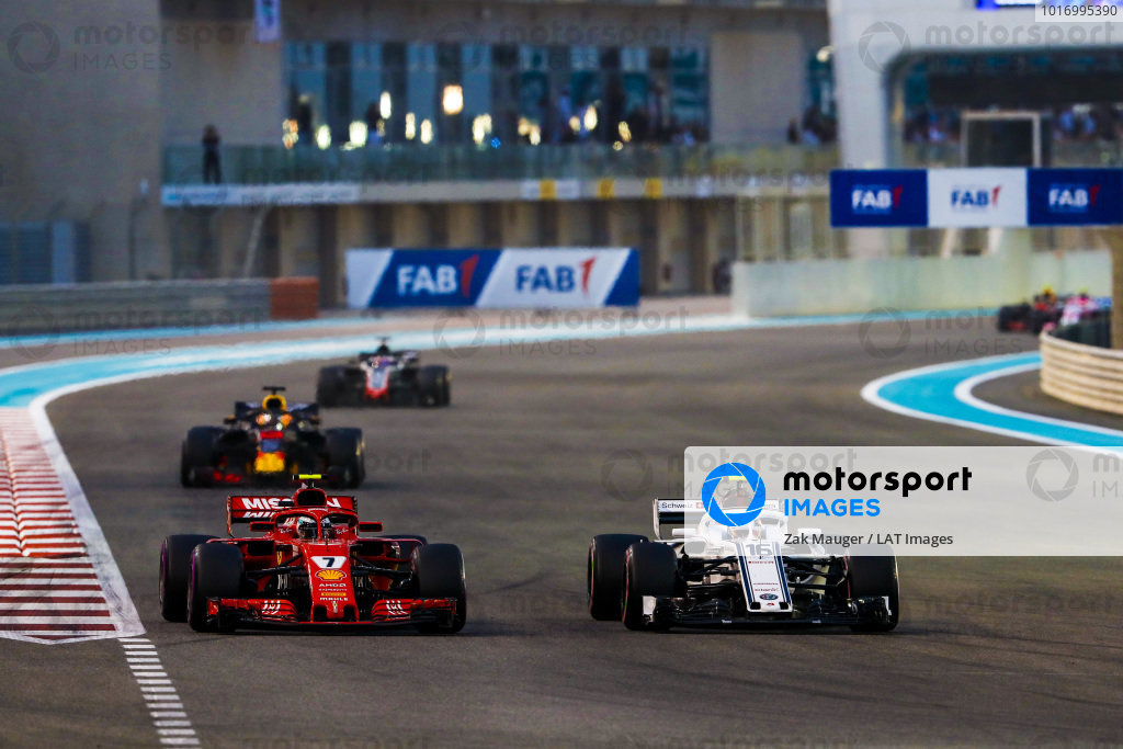 Charles Leclerc, Sauber C37 Ferrari, battles with Kimi Raikkonen, Ferrari SF71H, ahead of Daniel Ricciardo, Red Bull Racing RB14