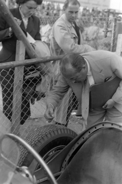 An official inspects the tyres on the Ferrari 500 shared by Luigi Villoresi and Alberto Ascari.