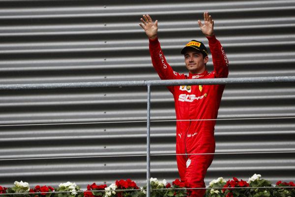 Charles Leclerc, Ferrari, celebrates victory on the podium