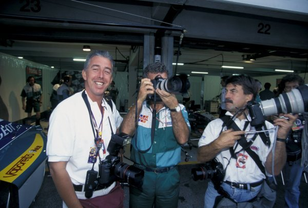 Eddie Jordan (IRE) Jordan team boss tries his hand at photography with Keith Sutton (GBR) Sutton Images CEO and Rainer Schlegilmilch (D) German Grand Prix, Hockenheim, Germany, 30 July 1995.