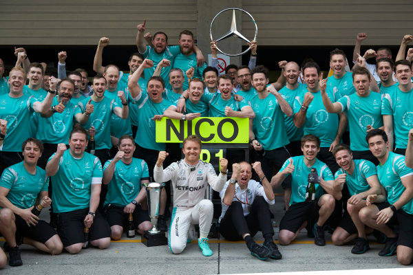 Shanghai International Circuit, Shanghai, China. Sunday 17 April 2016. Nico Rosberg, Mercedes AMG, 1st Position, Tony Ross, Race Engineer, Mercedes AMG, and the Mercedes team celebrate victory after the race. World Copyright: Steve Etherington/LAT Photographic ref: Digital Image SNE12627