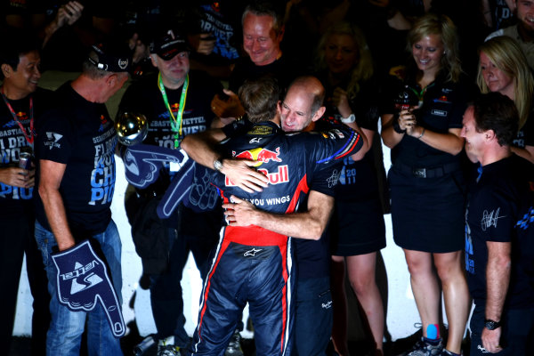 Suzuka Circuit, Suzuka, Japan.9th October 2011.Sebastian Vettel, Red Bull Racing RB7 Renault, 3rd position, is congratulated by Adrian Newey, Chief Technical Officer, Red Bull Racing. Portrait. Atmosphere. World Copyright: Andy Hone/LAT Photographicref: Digital Image CSP25904