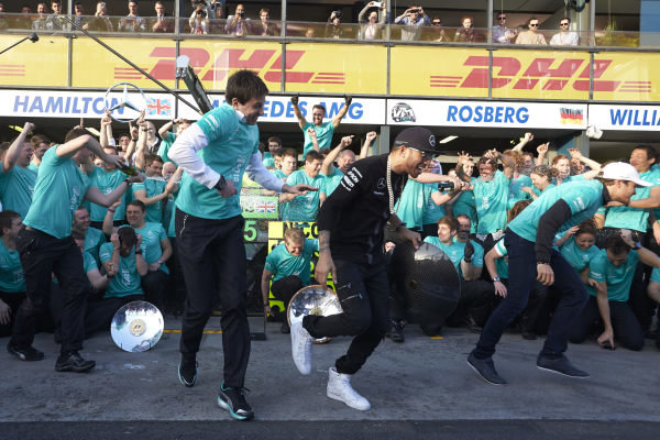 Albert Park, Melbourne, Australia. Sunday 15 March 2015. Lewis Hamilton, Mercedes AMG and Nico Rosberg, Mercedes AMG celebrate with their team after winning the race. World Copyright: Steve Etherington/LAT Photographic. ref: Digital Image SNE11622