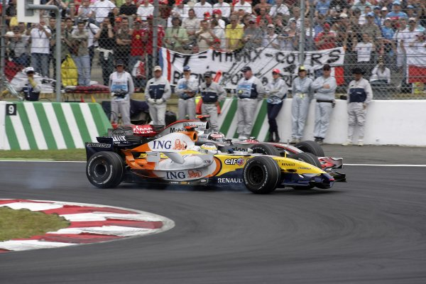 2007 French Grand Prix - Sunday RaceCircuit de Nevers Magny Cours, Nevers, France.1st July 2007.Giancarlo Fisichella, Renault R27, 6th position, leads Fernando Alonso, McLaren MP4-22 Mercedes, 7th position. Action. World Copyright: Andrew Ferraro/LAT Photographicref: Digital Image VY9E3412