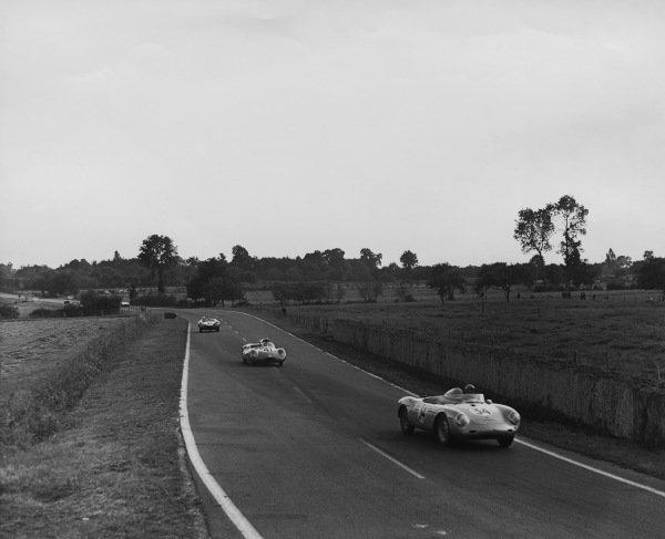 Le Mans, France. 21 - 22 June 1958.Jean Kerguen/Franc (Porsche 550A RS), 10th position, leads Jean Laroche/Remy Radix (Osca S750), 14th position, action. World Copyright: LAT PhotographicRef: B/WPRINT.