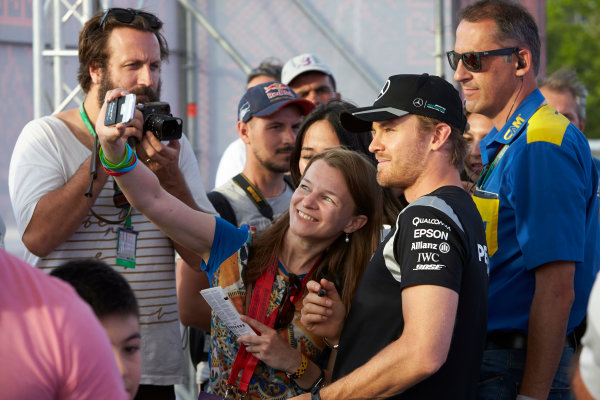 Baku City Circuit, Baku, Azerbaijan. Thursday 16 June 2016. Nico Rosberg, Mercedes AMG, poses for a photo with a fan. World Copyright: Steve Etherington/LAT Photographic ref: Digital Image SNE20724