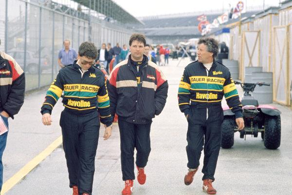 Daytona 24 Hours, Florida, USA. 2nd - 3rd February 1991. Rd 1. Left to Right: Jeff Andretti, Michael Andretti and Mario Andretti walk through the paddock, portrait. World Copyright: Bill Murenbeeld/LAT Photographic. Ref: 91IMSA DAY01.
