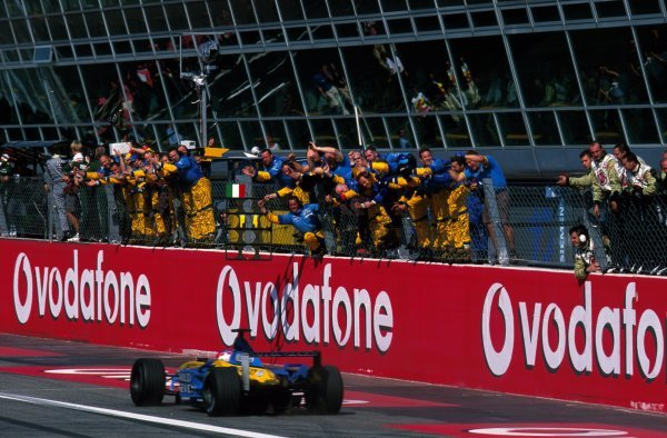 The Renault team celebrate as Jarno Trulli (FRA) Renault R202 storms from the back of the gird to finish fourth.