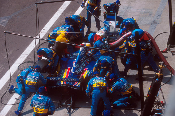 Hungaroring, Hungary.11-13 August 1995.Michael Schumacher (Benetton B195 Renault) pits for fuel  on the way to 11th position.Ref-95 HUN 11.World Copyright - LAT Photographic