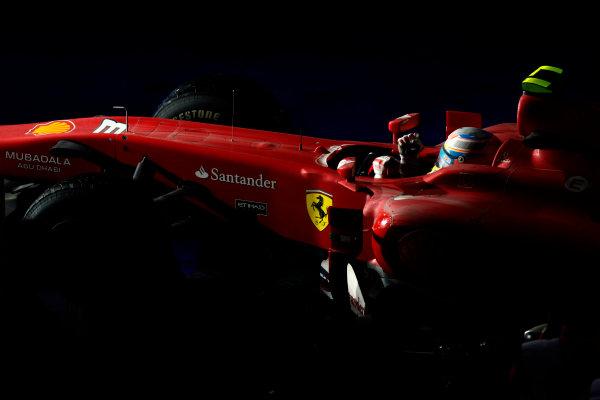 Korea International Circuit, Yeongam-Gun,South Korea. 24th October 2010. Fernando Alonso, Ferrari F10, 1st position, arrives in Parc Ferme. Portrait. Helmets. Finish. World Copyright:Glenn Dunbar/LAT Photographic ref: Digital Image _G7C2909