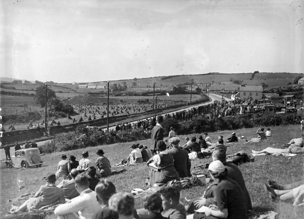 Fans find a good vantage point overlooking the circuit to watch the action.