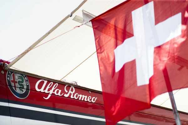 Alfa Romeo Racing hospitality with Swiss flags to celebrate National Swiss Day